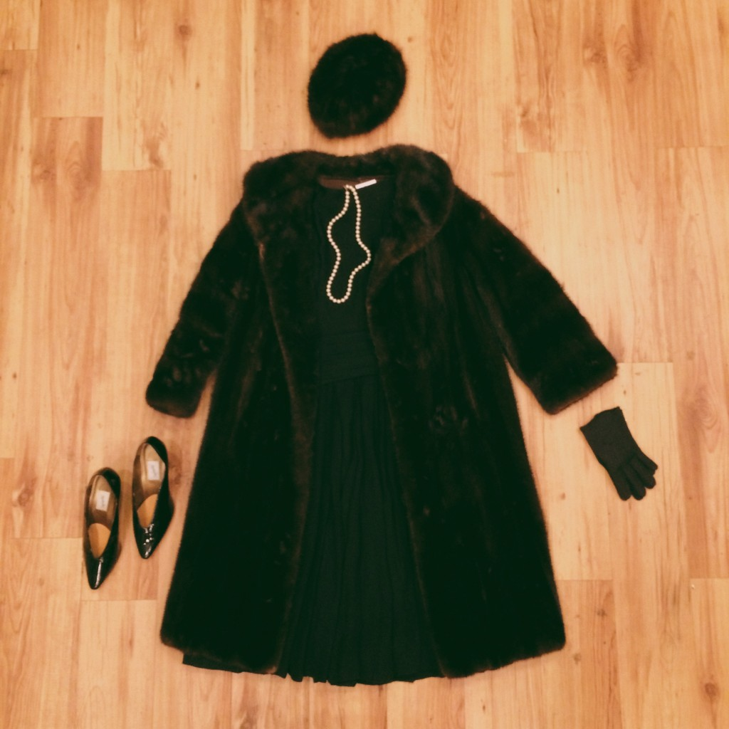 1950s black dress with full pleated chiffon skirt, XS, $73 1970s chocolate brown mink fur coat, S/M, $399 1950s mink fur beret, $35 1960s pearl necklace, $12 1960s black embroidered gloves, $12 1970s black patent leather heels, 6, $23