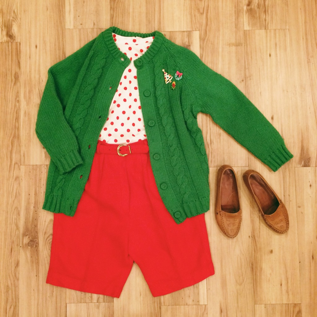 1960s red polka dot sleeveless top, M, $18 1960s bright green knit cardigan, S, $23 1960s bright red high-waisted wool shorts with belt, XS, $28 1960s colorful Christmas tree brooch, $14 1970s Christmas wreath brooch, $10 1970s mistletoe pin, $9 1970s brown leather flats, 6, $23